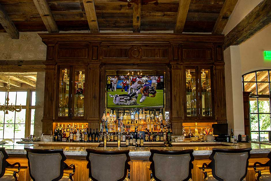 Houston Oaks Country Club recessed flat panel LED TV monitor over bar