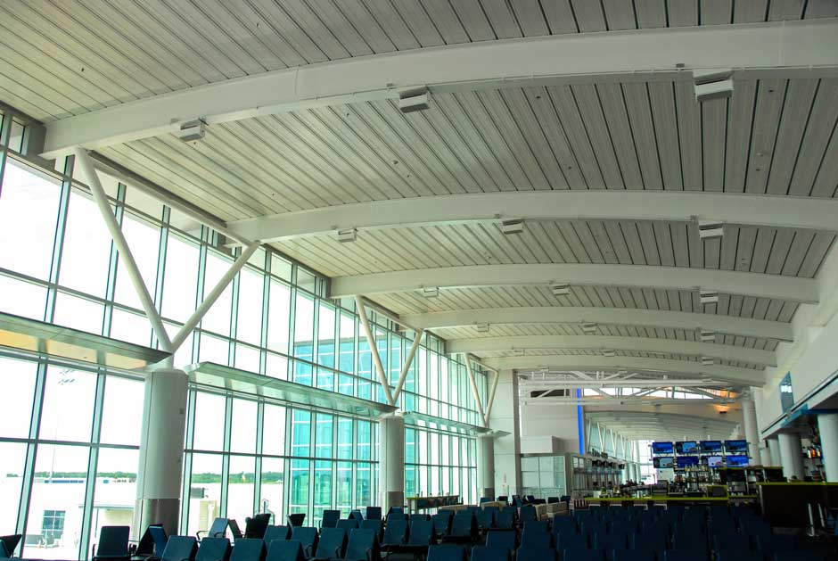 Airport gate area overhead audio speaker system