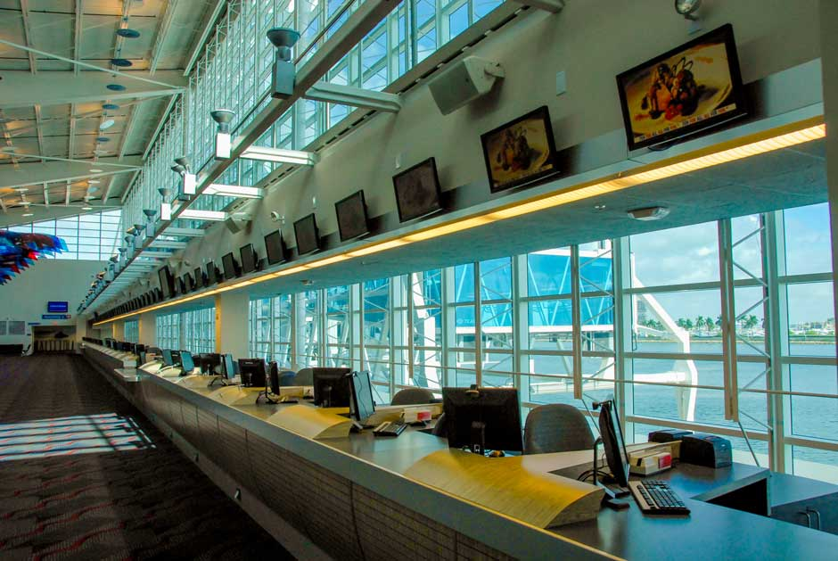 Carnival Cruise Lines ticket counter overhead video display screens