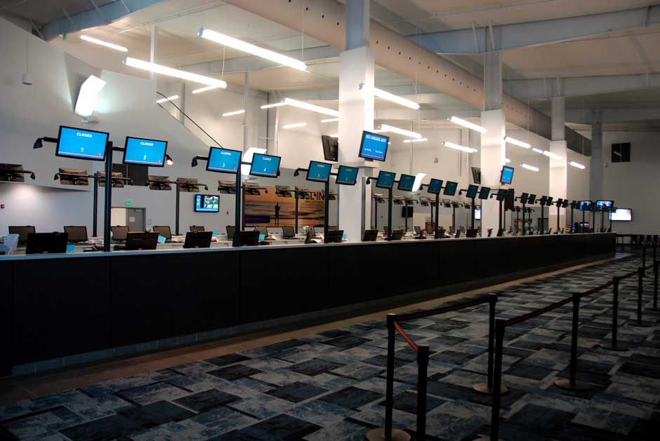 Carnival Cruise Lines ticket counter overhead video monitors for queuing control system