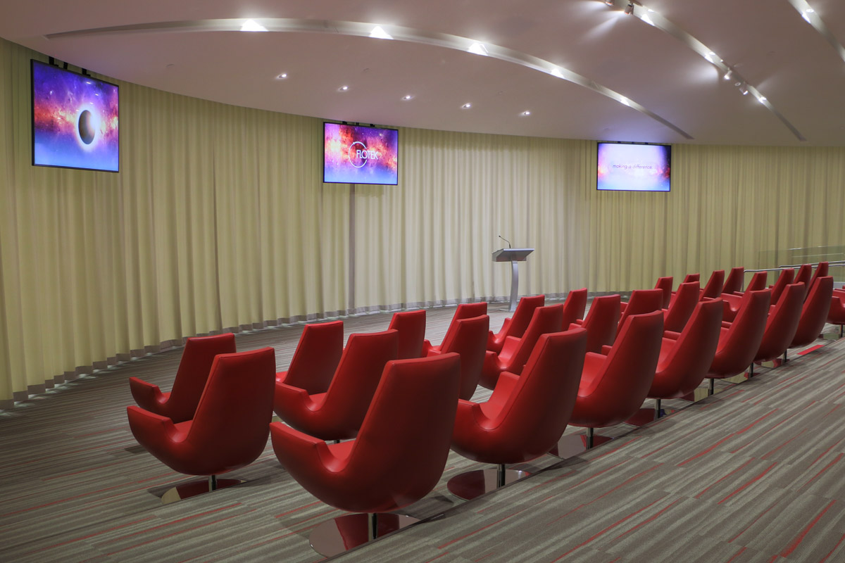 Flotek AV collaboration room meeting space motorized LED video displays