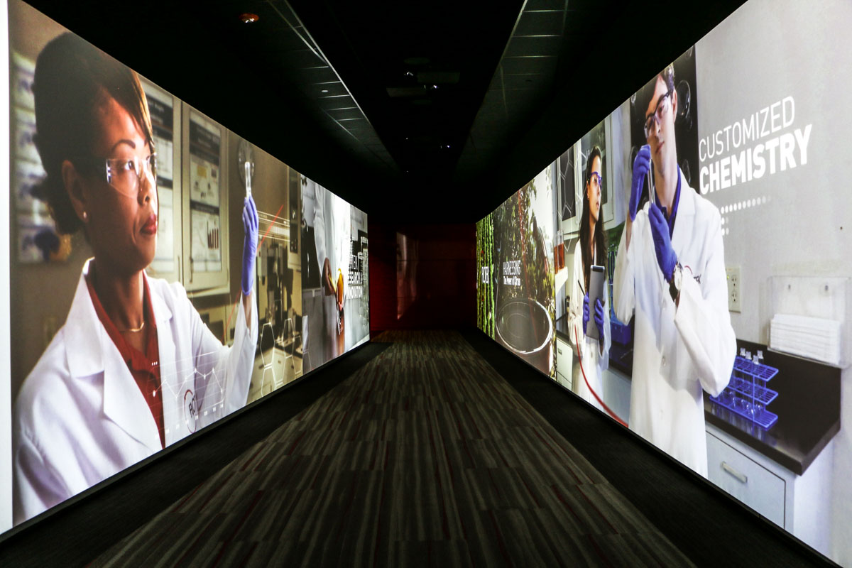 Flotek lobby center interactive media tunnel video wall projection