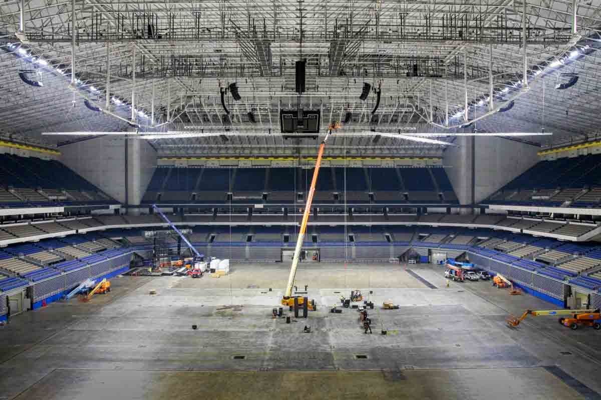 Alamodome public address audio distribution speaker rigging with boom lift installation