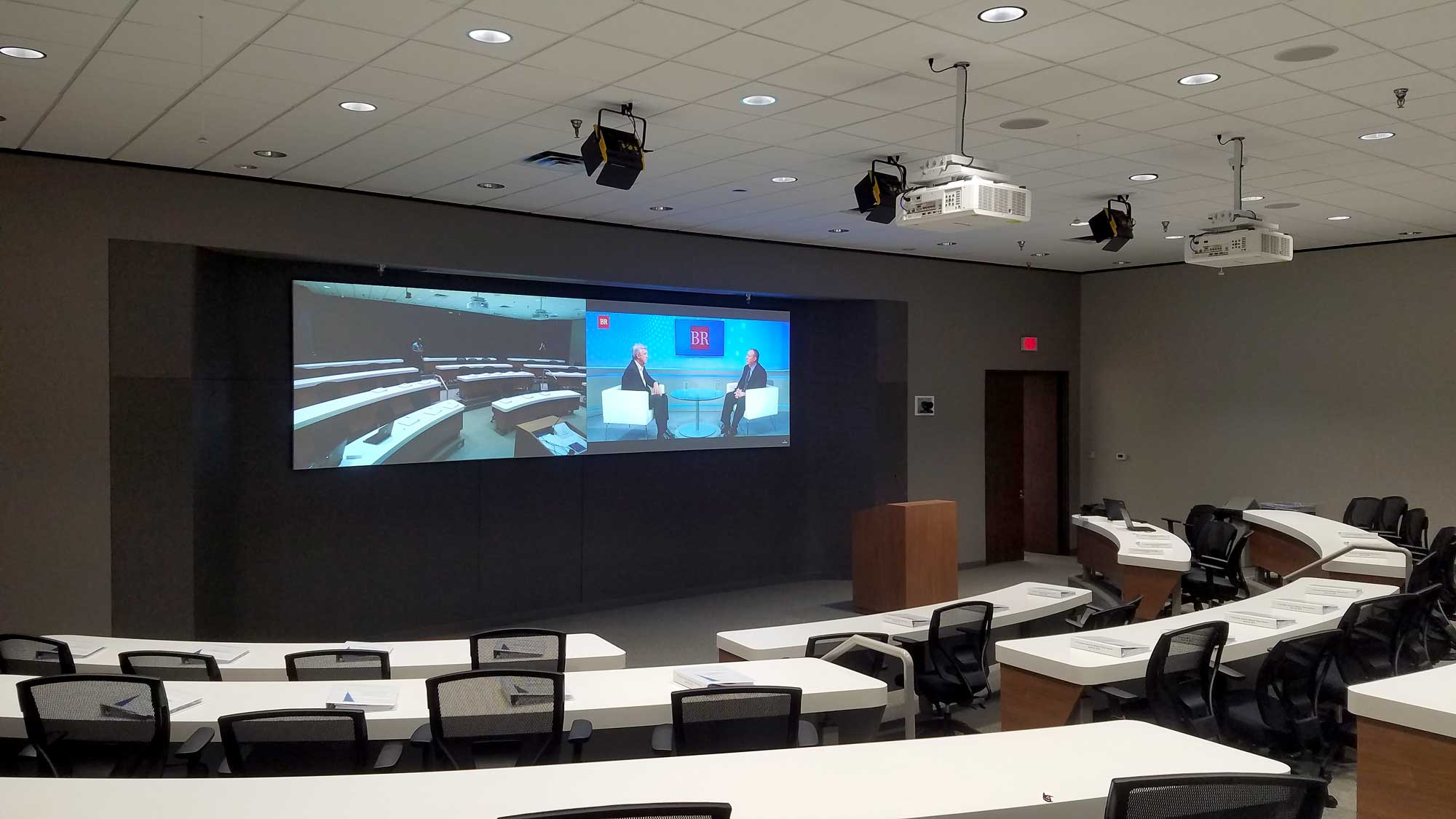 Emerson video conferencing and collaboration center audio speakers and video projection system