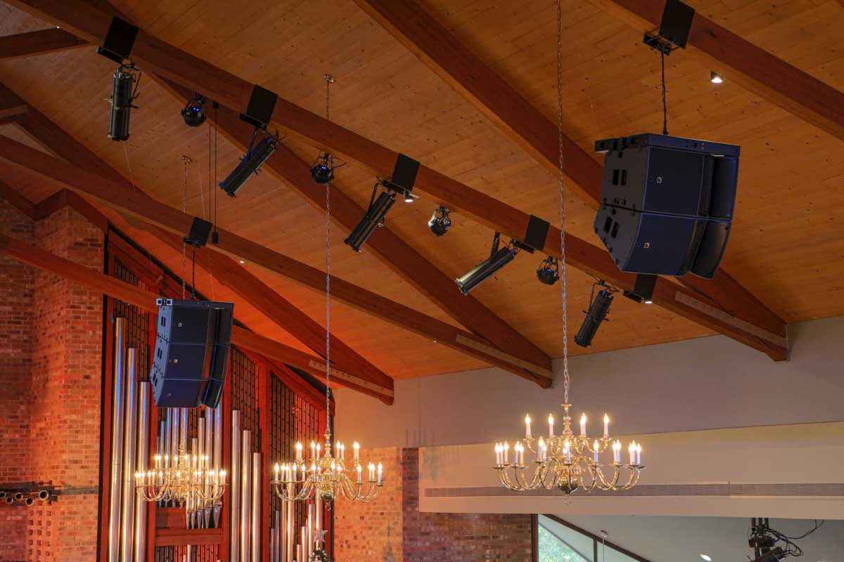 LAcoustics A15 speaker arrays hanging from sanctuary ceiling
